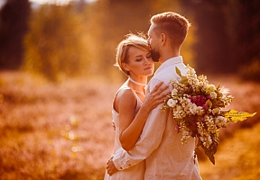 1521466105the-charming-girl-keeps-a-bouquet-and-embracing-her-boy_8353-2754.jpg