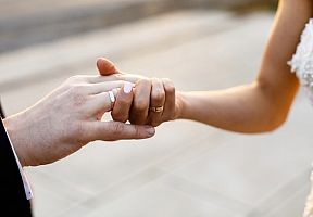 1529327070bride-and-groom-hold-each-other-hands-with-wedding-rings_8353-548.jpg